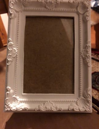 A white flowery frame COLLECTION ONLY