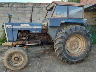 Tractor, remolque, sembradora, rejas y cultivadora