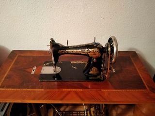 2 máquinas de coser.