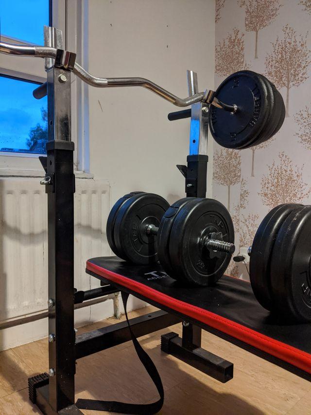 Adjustable gym bench with EZ bar, 2 dumbbells