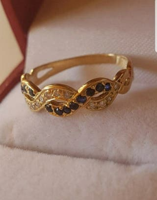 Anillo infinito de oro 18KT. zafiro y diamantes