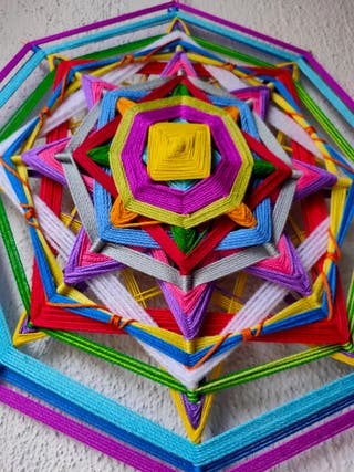 Mandala tejida, ojo de Dios