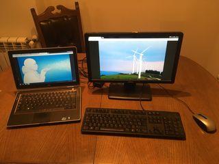 Portátil Dell con base de trabajo