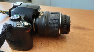 cámara Nikon D60 + objetivo 28-210