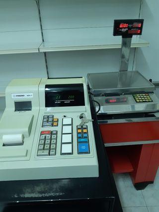 Máquina registradora y báscula electrónica.