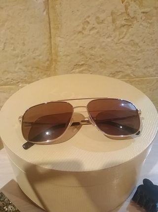se vende gafas de sol flamante puesto 2veces son p