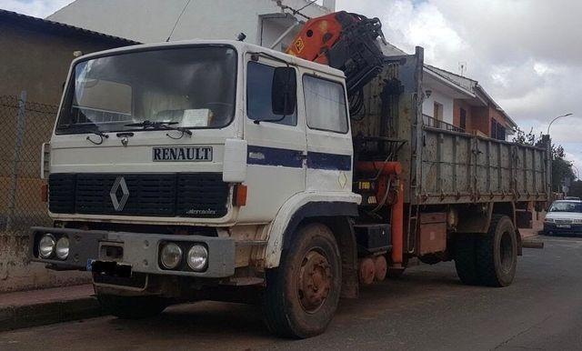Camión basculante Renault y tarjeta de transporte