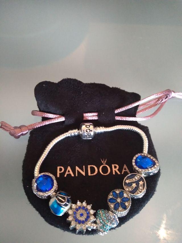 Pandora Bracelet (kids) with random charms. New