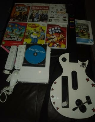 Nintendo Wii with 8 games & Guitar