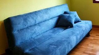 sofá azul combertible en cama