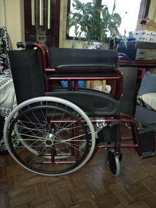 Silla de ruedas plegable, autopropulsada roja