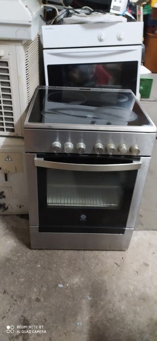 vendo un horno con vitro arriba todo curvado