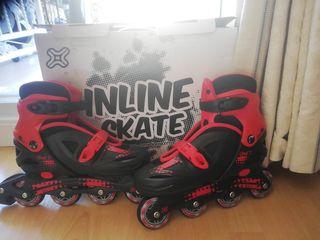 inline skate rojo y negro con caja