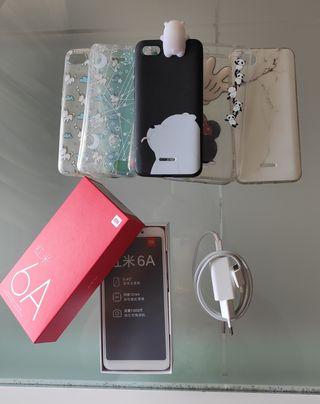 Xiaomi Redmi 6A+cargador+8 fundas