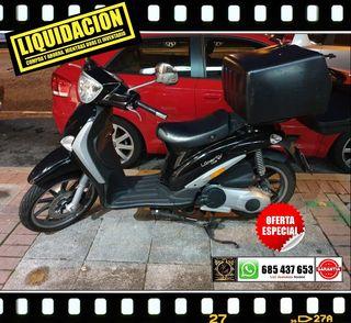 Piaggio liberty de 125 cc, negra, con 3600 Km año