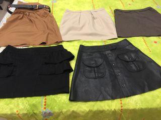 5 faldas cortas, t 38, precio todas 8€. De marca.