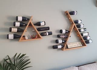 Soportes botellas vino pared