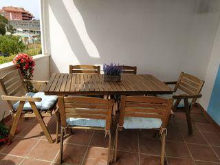 mesa de jardín de madera incluyendo 6 sillas y coj