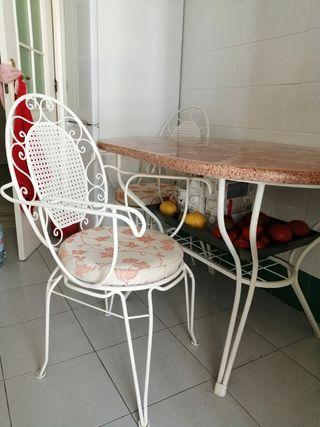Mesa de mármol con 6 sillas