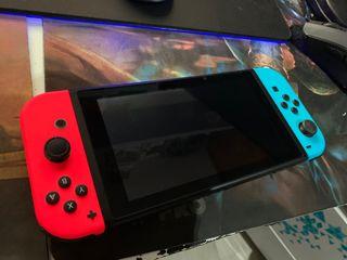 Nintendo switch como nueva con mandos y 4 juegos!