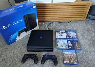 PS4 pro with box and games