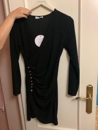 vestido negro de purpurina con escote es v