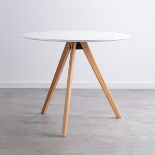 Mesa de comedor redonda de color blanco