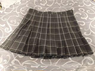 Falda escolar de cuadros negra 9€