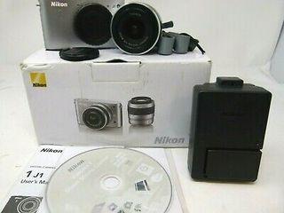 cámara de fotos nikon j1