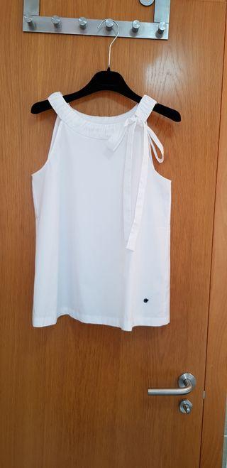 Blusa blanca sin mangas de algodón. Lion of Porche