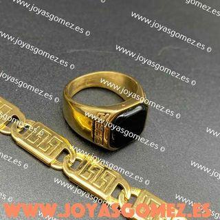pulsera greca y anillo piedra negra.