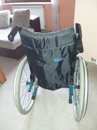 Silla de ruedas y regalo