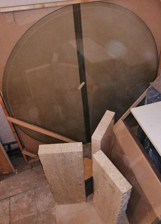 Mesa redonda de cristal con pie de marmol