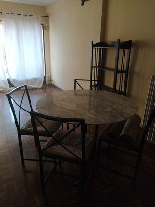 Mesa redonda de comedor mármol y hierro