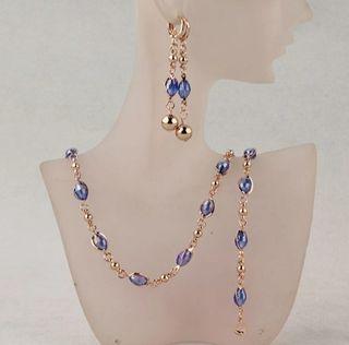 conjunto collar, pulsera y pendientes azul