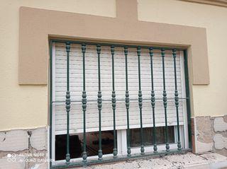 ventanas de aluminio con rejas de hierro massiso