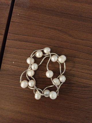 3 bracelets de perles et d'argent