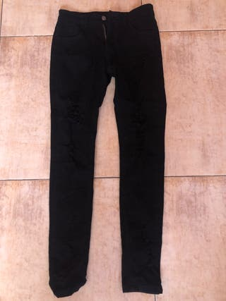 Pantalones rotos negros