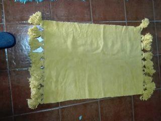 Alfombra de algodón con pompones