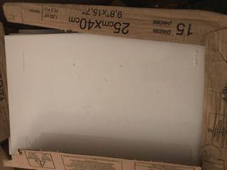 7 cajas de azulejo blanco