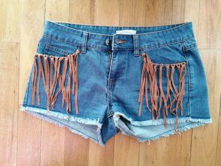 Shorts con flecos