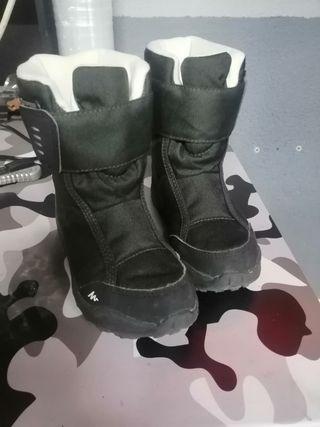 botas de nieve y agua