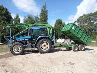 Tractor New Holland con grúa y remolque