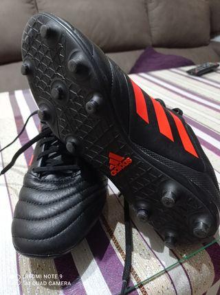 botas de fútbol tacos