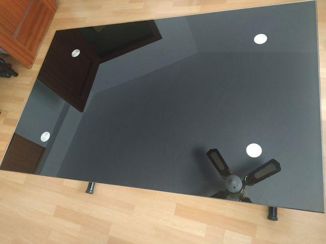 Mesa de cristal elevable