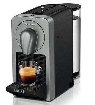 Cafetera nespresso + dispensador original