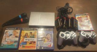 Play Station 2, con 2 mandos y con 4 juegos