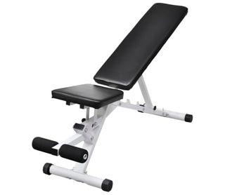 Banco de ejercicios con juego de pesas y mancuerna
