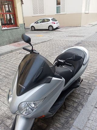 motoclcleta hondaforza:5EX
