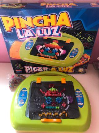 Juego Pincha la Luz